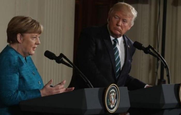 """ترامب يطالب ميركل بـ""""مبالغ مالية هائلة"""" نظير الدفاع عن ألمانيا"""