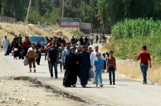 بالصور: أهل الموصل يعودون إلى ديارهم بعد 3 أعوام من الهجرة والنزوح