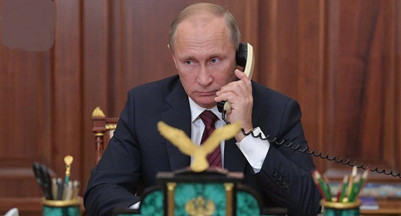 السيسي يهنئ بوتين هاتفيا